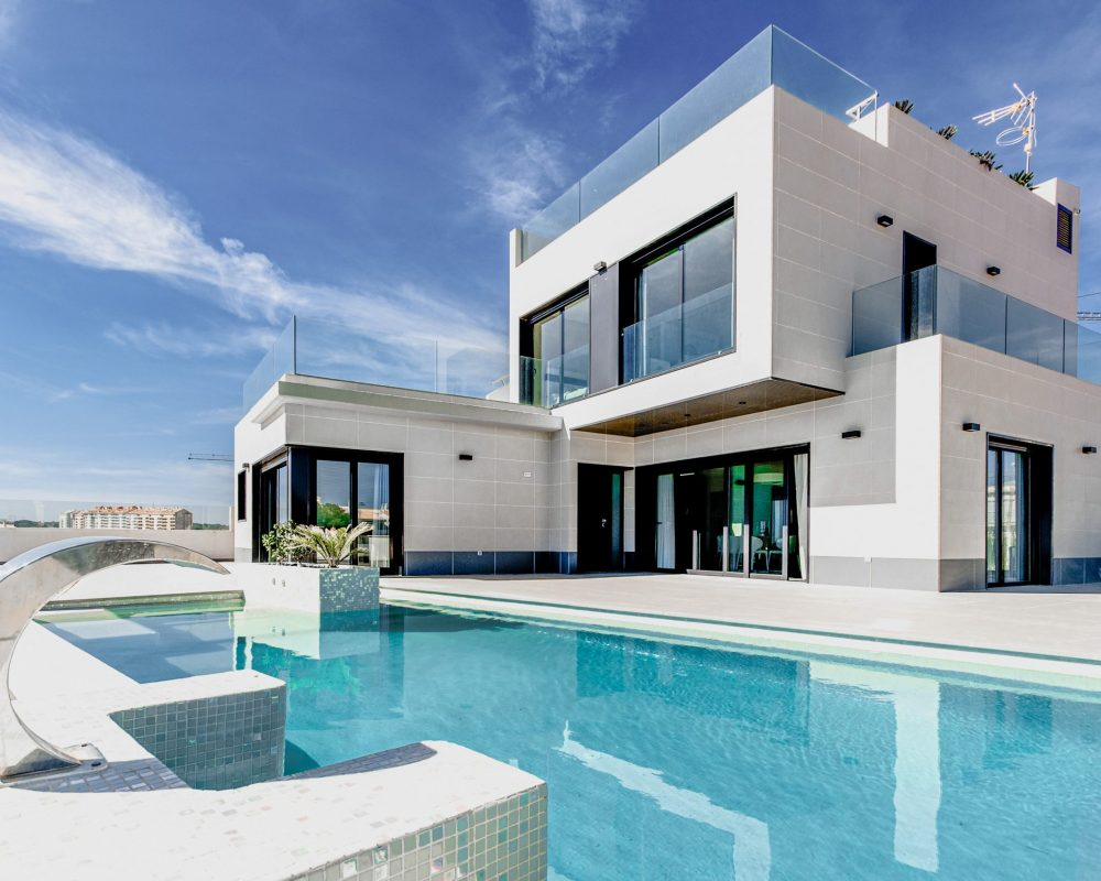 modern house with white concrete pool deck & swimming pool